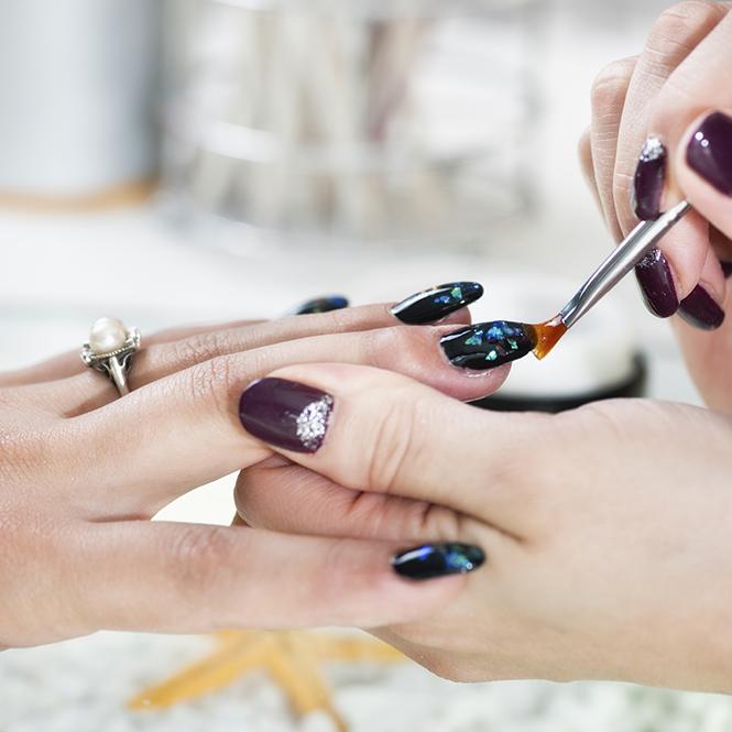 Woman doing nail art in nail salon